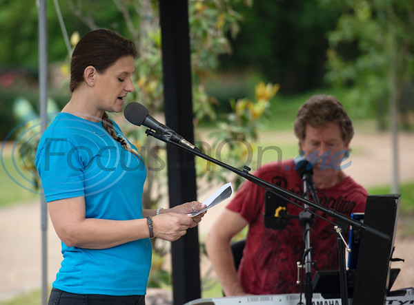 Heather Ogg reads a poem at the Tyler Compassionate Friends butterfly release at The Children's Park on Saturday May 18, 2019. Ogg's son Tanner Douglas who died at age 16.   (Sarah A. Miller/Tyler Morning Telegraph)