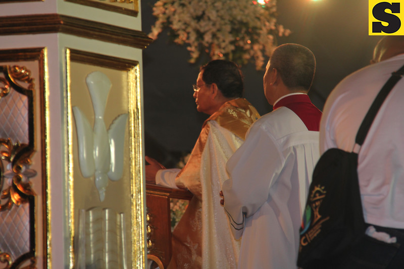 Papal legate Charles Maung Cardinal Bo praying during IEC Benediction