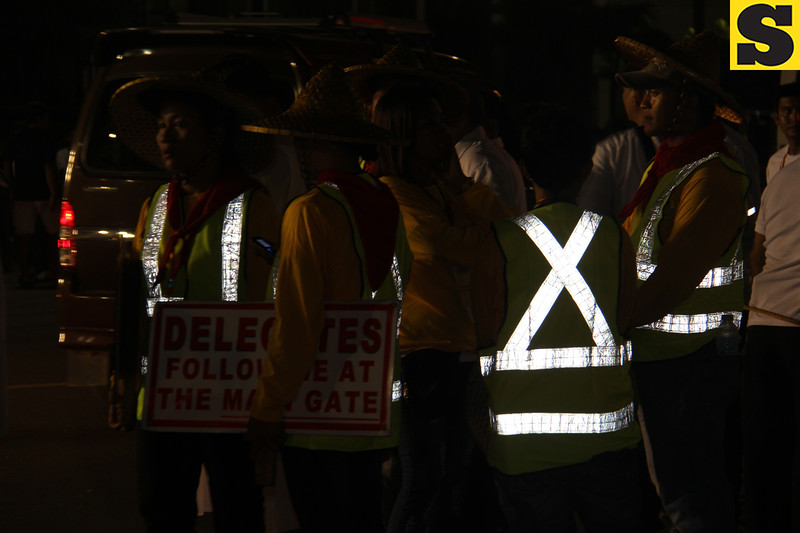 Vest reflectors worn by usherettes during IEC grand procession