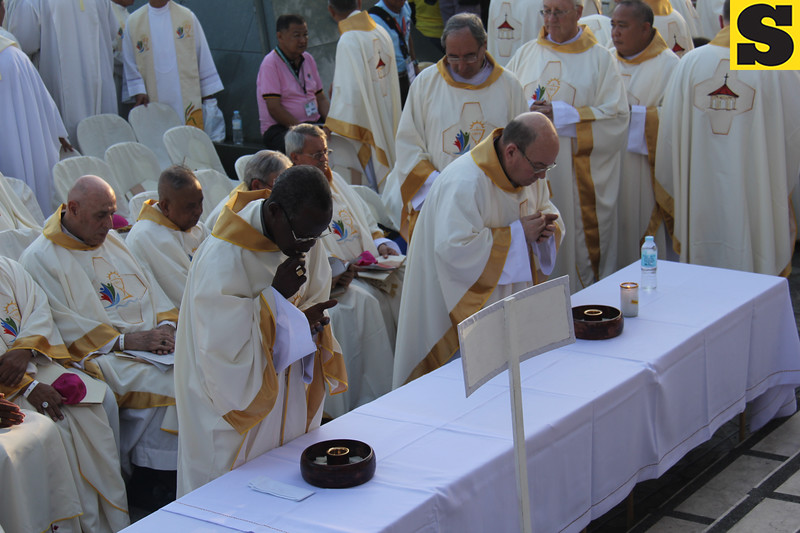 Bishops take Holy Communion during IEC Capitol Mass