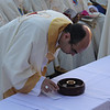 A priest taking the Holy Communion