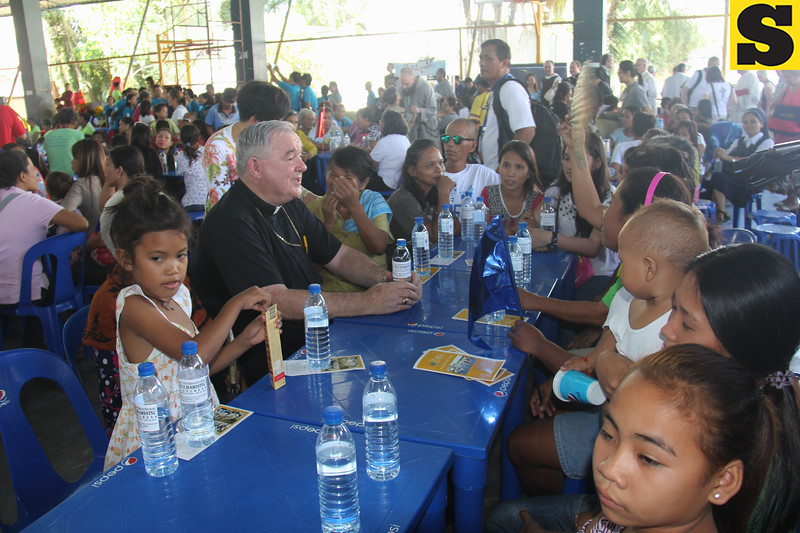Archbishop of Winnipeg, Canada Richard Gagnon shares a table with poor Cebuanos