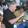 Archbishop of Winnipegm Canada Richard Gagnon talks to a Cebuano woman
