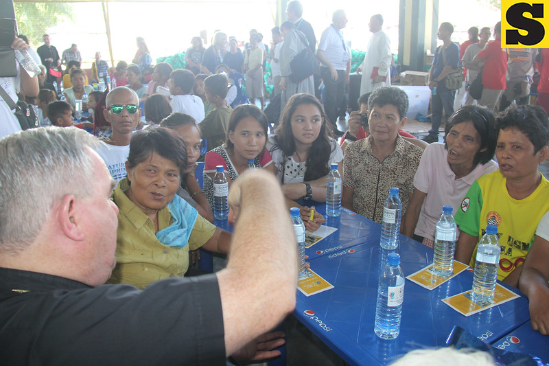 Cebuanos intently listen to Archibishop of Winnipeg, Canada Richard Gagnon