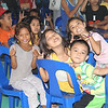 Children from poor families pose for a photo during the Table of Hope Banquet