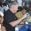 Archbishop of Winnipegm Canada Richard Gagnon talks to a Cebuano woman