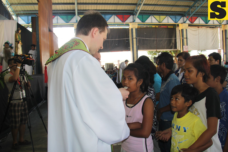 Children receive Holy communion during the Table of Hope Banquet