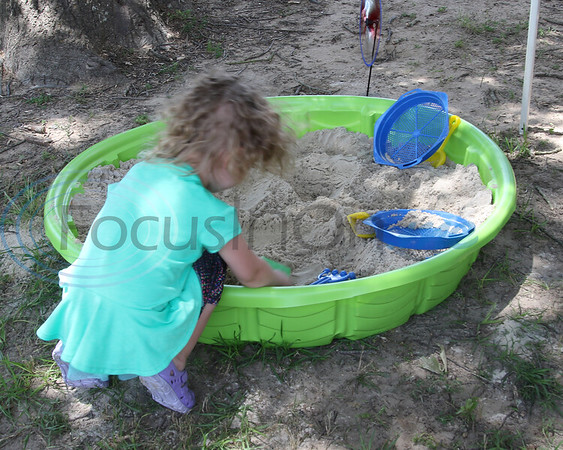 Lexi Bisnette, 3, searches the sand for treasure at the Whitehouse 'Freedom In The Park' day on Memorial Day, May 25, 2019, at the Whitehouse City Park, Whitehouse, Tx. (Rick Flack Photo)