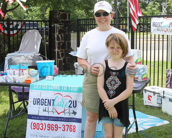 Vendor Kym Catlin, and Clara, representing Urgent Care 2U, at the Whitehouse 'Freedom In The Park' day on Memorial Day, May 25, 2019, at the Whitehouse City Park, Whitehouse, Tx. (Rick Flack Photo)