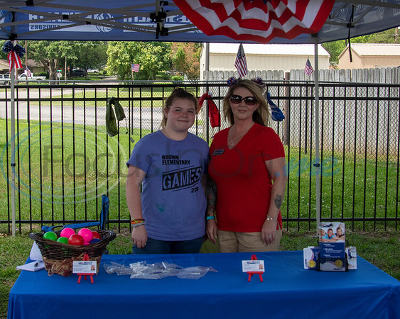 US Health Advisors Licensed agent Costa Brown (r) and Jaycee Walbridge (l) at the Whitehouse 'Freedom In The Park' day on Memorial Day, May 25, 2019, at the Whitehouse City Park, Whitehouse, Tx. (Rick Flack Photo)