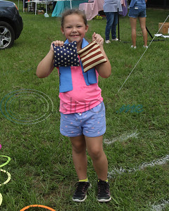 Emma Kate Driggers, 7, enjoys the bean bag toss gaame at the Whitehouse 'Freedom In The Park' day on Memorial Day, May 25, 2019, at the Whitehouse City Park, Whitehouse, Tx. (Rick Flack Photo)
