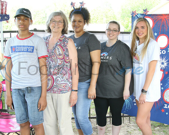 From left, Tony Attaway, Kay Taylor, Conne Attaway, Jessica Mc Coy, and Kaitlin Hossley representing Farmers Insurance at the Whitehouse 'Freedom In The Park' day on Memorial Day, May 25, 2019, at the Whitehouse City Park, Whitehouse, Tx. (Rick Flack Photo)