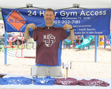 """Anthony Johnson, Executive Director for 'The Rec"""", shows off T-shirts during the  Whitehouse 'Freedom In The Park' day on Memorial Day, May 25, 2019, at the Whitehouse City Park, Whitehouse, Tx. (Rick Flack Photo)"""