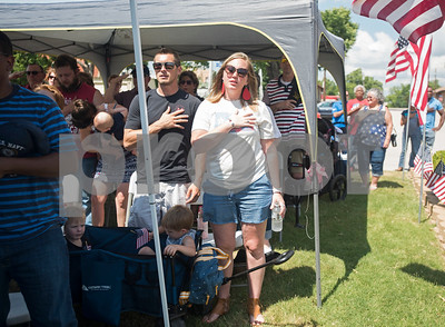 People sing the National Anthem at a Memorial Day ceremony held at the Lindale Veterans Memorial in Lindale on Monday May 28, 2018. The event was hosted by the Lindale Veterans Memorial Committee and Lindale American Legion Post 15. Memorial Day is observed to remember people who served in United States armed forces and died during their service.   (Sarah A. Miller/Tyler Morning Telegraph)