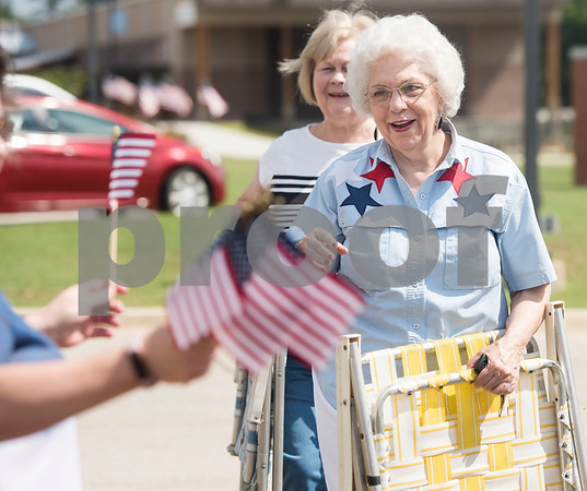 Annie Baldwin of Lindale receives an American flag at the Memorial Day ceremony held at the Lindale Veterans Memorial in Lindale on Monday May 28, 2018. Baldwin is part of a Gold Star family. Her brother Franklin Coomer was killed in World War II in Okinawa, Japan. The event was hosted by the Lindale Veterans Memorial Committee and Lindale American Legion Post 15. Memorial Day is observed to remember people who served in United States armed forces and died during their service.   (Sarah A. Miller/Tyler Morning Telegraph)