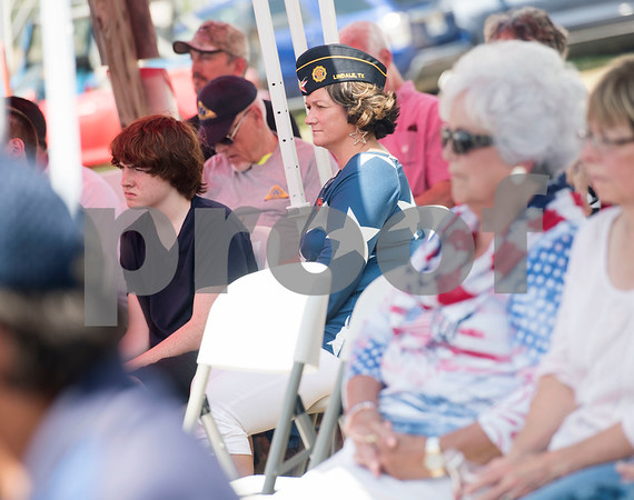 People attend a Memorial Day ceremony held at the Lindale Veterans Memorial in Lindale on Monday May 28, 2018. The event was hosted by the Lindale Veterans Memorial Committee and Lindale American Legion Post 15. Memorial Day is observed to remember people who served in United States armed forces and died during their service.   (Sarah A. Miller/Tyler Morning Telegraph)