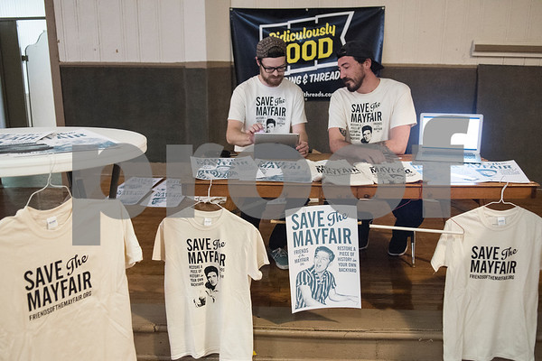 Loren Roe and Justin West of Ridiculously Good Branding & Threads sell Save the Mayfair shirts at the subject marker dedication celebration for the Mayfair Building Wednesday May 31, 2017 in Tyler.  (Sarah A. Miller/Tyler Morning Telegraph)