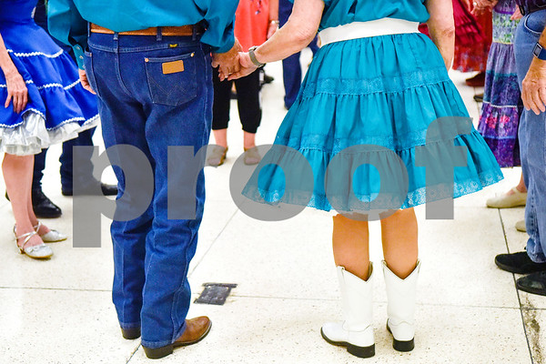 A couple prepares to square dance during the 56th Annual Square and Round Dance Festival hosted by the Texas State Federation of Square and Round Dancers at Harvey Convention Center in Tyler, Texas, on Thursday, May 31, 2018. The theme of the festival is Dancing is Good in the Piney Woods. (Chelsea Purgahn/Tyler Morning Telegraph)