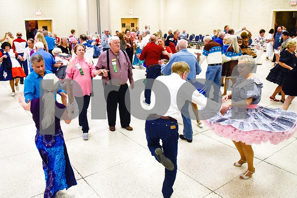 People square dance during the 56th Annual Square and Round Dance Festival hosted by the Texas State Federation of Square and Round Dancers at Harvey Convention Center in Tyler, Texas, on Thursday, May 31, 2018. The theme of the festival is Dancing is Good in the Piney Woods. (Chelsea Purgahn/Tyler Morning Telegraph)