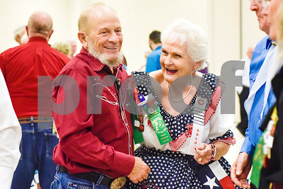 Wally Allen and Dorthy Morgan laugh during the 56th Annual Square and Round Dance Festival hosted by the Texas State Federation of Square and Round Dancers at Harvey Convention Center in Tyler, Texas, on Thursday, May 31, 2018. The theme of the festival is Dancing is Good in the Piney Woods. (Chelsea Purgahn/Tyler Morning Telegraph)