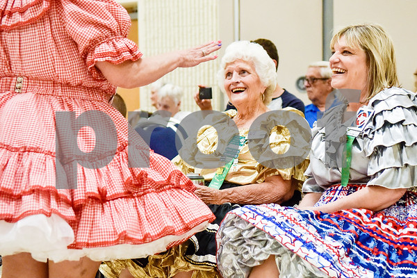 Linda Carlile, left, chats with Dorris Willis and Diane Doyle during the 56th Annual Square and Round Dance Festival hosted by the Texas State Federation of Square and Round Dancers at Harvey Convention Center in Tyler, Texas, on Thursday, May 31, 2018. The theme of the festival is Dancing is Good in the Piney Woods. (Chelsea Purgahn/Tyler Morning Telegraph)