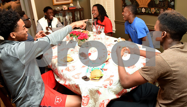 John Tyler High School students eat homemade hamburgers during Young Life Wednesday night May 4, 2016 in Tyler. Young Life Tyler is an organization that seeks to share God's love with kids through the simple act of being present in their lives. Tyler Young Life is the longest consecutive running young life club in the world and has grown.    (Sarah A. Miller/Tyler Morning Telegraph)