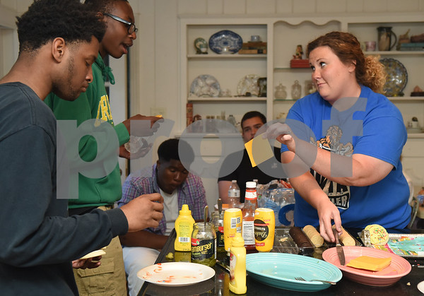 Volunteer Kat Ledkins passes out hamburger condiments to John Tyler High School students during Young Life Wednesday night May 4, 2016 in Tyler. Young Life Tyler is an organization that seeks to share God's love with kids through the simple act of being present in their lives. Tyler Young Life is the longest consecutive running young life club in the world and has grown.    (Sarah A. Miller/Tyler Morning Telegraph)