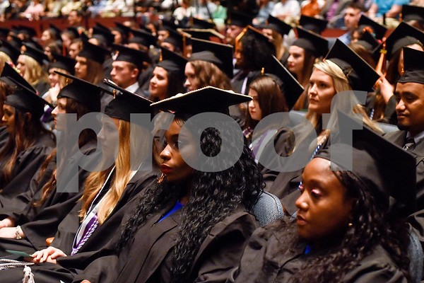 Graduates listen during the University of Texas at Tyler's commencement ceremony at UT Tyler in Tyler, Texas, on Friday, May 4, 2018. More than 1,200 graduates received degrees. (Chelsea Purgahn/Tyler Morning Telegraph)