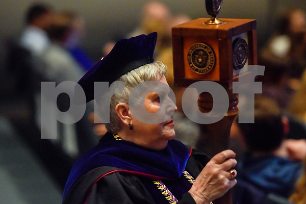 A faculty member walks in the processional during the University of Texas at Tyler's commencement ceremony at UT Tyler in Tyler, Texas, on Friday, May 4, 2018. More than 1,200 graduates received degrees. (Chelsea Purgahn/Tyler Morning Telegraph)