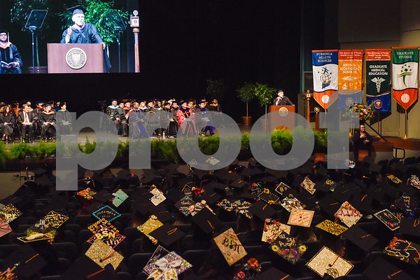 Keynote speaker Billy Hibbs Jr., chairman and CEO of Heartland Security Insurance Group, speaks during the University of Texas at Tyler's commencement ceremony at UT Tyler in Tyler, Texas, on Friday, May 4, 2018. More than 1,200 graduates received degrees. (Chelsea Purgahn/Tyler Morning Telegraph)