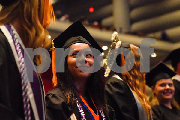 Beatriz Colunga stands with other graduates during the University of Texas at Tyler's commencement ceremony at UT Tyler in Tyler, Texas, on Friday, May 4, 2018. More than 1,200 graduates received degrees. (Chelsea Purgahn/Tyler Morning Telegraph)