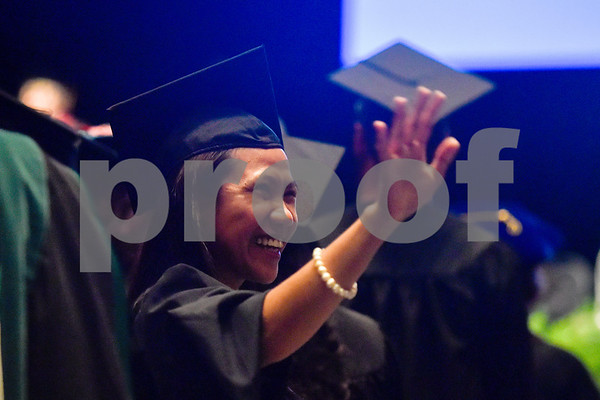 Vicky Serdan smiles and waves during the University of Texas at Tyler's commencement ceremony at UT Tyler in Tyler, Texas, on Friday, May 4, 2018. More than 1,200 graduates received degrees. (Chelsea Purgahn/Tyler Morning Telegraph)