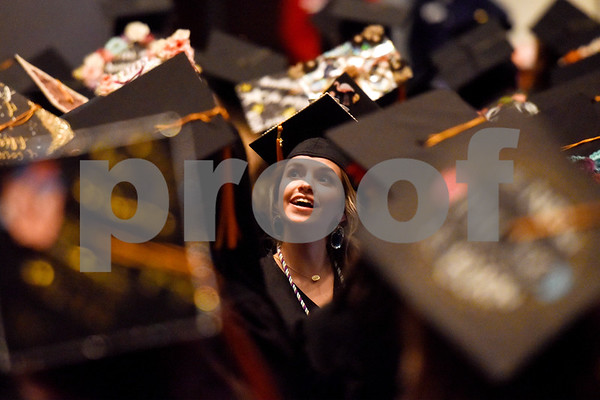 A graduate looks at the audience during the University of Texas at Tyler's commencement ceremony at UT Tyler in Tyler, Texas, on Friday, May 4, 2018. More than 1,200 graduates received degrees. (Chelsea Purgahn/Tyler Morning Telegraph)