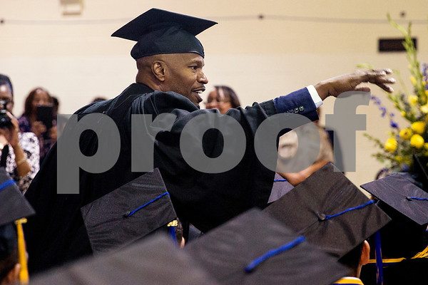 Jamie Foxx greets students during Jarvis Christian College's commencement at Jarvis Christian College in Hawkins, Texas, on Saturday, May 5, 2018. Jesse J. Holland, race and ethnicity writer for the Associated Press, gave the keynote address, and Foxx received an honorary doctorate degree from the college. (Chelsea Purgahn/Tyler Morning Telegraph)
