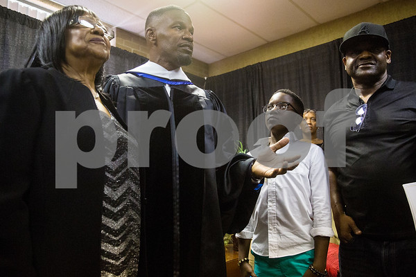 Barbara Willie stands with her godson Jamie Foxx as he addresses the media during Jarvis Christian College's commencement at Jarvis Christian College in Hawkins, Texas, on Saturday, May 5, 2018. Jesse J. Holland, race and ethnicity writer for the Associated Press, gave the keynote address, and Jamie Foxx received an honorary doctorate degree from the college. (Chelsea Purgahn/Tyler Morning Telegraph)