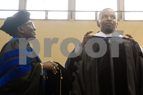 Provost and Vice President for Academic Affairs Glenell Lee-Pruitt watches as president Lester Newman puts a doctorate hood on Jamie Foxx during Jarvis Christian College's commencement at Jarvis Christian College in Hawkins, Texas, on Saturday, May 5, 2018. Jesse J. Holland, race and ethnicity writer for the Associated Press, gave the keynote address, and Foxx received an honorary doctorate degree from the college. (Chelsea Purgahn/Tyler Morning Telegraph)