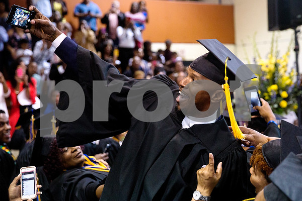 Jamie Foxx takes a selfie with students during Jarvis Christian College's commencement at Jarvis Christian College in Hawkins, Texas, on Saturday, May 5, 2018. Jesse J. Holland, race and ethnicity writer for the Associated Press, gave the keynote address, and Foxx received an honorary doctorate degree from the college. (Chelsea Purgahn/Tyler Morning Telegraph)