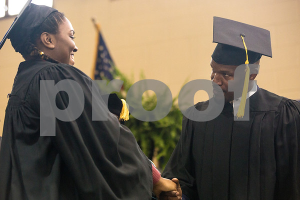 Jamie Foxx shakes a graduate's hand during Jarvis Christian College's commencement at Jarvis Christian College in Hawkins, Texas, on Saturday, May 5, 2018. Jesse J. Holland, race and ethnicity writer for the Associated Press, gave the keynote address, and Foxx received an honorary doctorate degree from the college. (Chelsea Purgahn/Tyler Morning Telegraph)