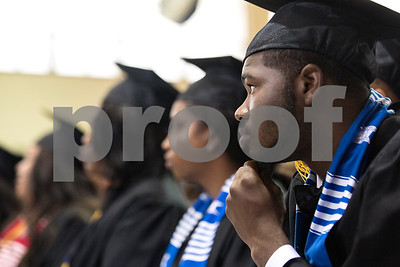 Christopher Mays listens during Jarvis Christian College's commencement at Jarvis Christian College in Hawkins, Texas, on Saturday, May 5, 2018. Jesse J. Holland, race and ethnicity writer for the Associated Press, gave the keynote address, and Jamie Foxx received an honorary doctorate degree from the college. (Chelsea Purgahn/Tyler Morning Telegraph)