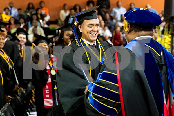 Isaiah Lopez shakes president Lester Newman's hand as he receives his degree during Jarvis Christian College's commencement at Jarvis Christian College in Hawkins, Texas, on Saturday, May 5, 2018. Jesse J. Holland, race and ethnicity writer for the Associated Press, gave the keynote address, and Jamie Foxx received an honorary doctorate degree from the college. (Chelsea Purgahn/Tyler Morning Telegraph)