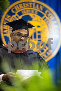 Jesse J. Holland, race and ethnicity writer for the Associated Press, waits to give the keynote address during Jarvis Christian College's commencement at Jarvis Christian College in Hawkins, Texas, on Saturday, May 5, 2018. Holland gave the keynote address, and Jamie Foxx received an honorary doctorate degree from the college. (Chelsea Purgahn/Tyler Morning Telegraph)