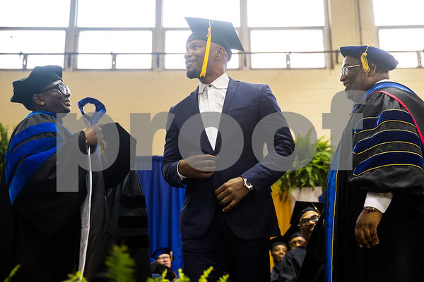 Provost and Vice President for Academic Affairs Glenell Lee-Pruitt, left, and president Lester Newman, right, prepare to give Jamie Foxx, center, his honorary doctorate degree during Jarvis Christian College's commencement at Jarvis Christian College in Hawkins, Texas, on Saturday, May 5, 2018. Jesse J. Holland, race and ethnicity writer for the Associated Press, gave the keynote address, and Jamie Foxx received an honorary doctorate degree from the college. (Chelsea Purgahn/Tyler Morning Telegraph)
