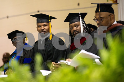 Jamie Foxx, second from left, listens during Jarvis Christian College's commencement at Jarvis Christian College in Hawkins, Texas, on Saturday, May 5, 2018. Jesse J. Holland, race and ethnicity writer for the Associated Press, gave the keynote address, and Foxx received an honorary doctorate degree from the college. (Chelsea Purgahn/Tyler Morning Telegraph)
