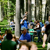 Record-Eagle/Keith King<br /> Jeff Godin, of Traverse City, carries his son Mason Godin, 3, while his son Aaron Godin, 5, at right, walks near as the group walk toward the beverage tent while Jeff's wife, Rose Godin, to right of Aaron, secures a table Sunday, May 22, 2011 during the 56th annual Northwestern Michigan College Barbecue.