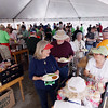 Record-Eagle/Keith King<br /> Martha Ealy, of Manton, and her husband Ray, are served food Sunday, May 22, 2011 during the 56th annual Northwestern Michigan College Barbecue.