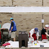 Record-Eagle/Keith King<br /> Volunteers prepare food Sunday, May 22, 2011 during the 56th annual Northwestern Michigan College Barbecue.