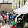Record-Eagle/Keith King<br /> Attendees walk toward the tent where food is served Sunday, May 22, 2011 during the 56th annual Northwestern Michigan College Barbecue.