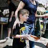 Record-Eagle/Keith King<br /> Emmett Dahl, 5, of Traverse City, walks toward the beverage tent carrying a plate of food alongside his mother, Stacey Dahl, Sunday, May 22, 2011 during the 56th annual Northwestern Michigan College Barbecue.