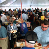 Record-Eagle/Keith King<br /> Attendees make their way under the tent where food is served Sunday, May 20, 2012 during the 57th annual Northwestern Michigan College Barbecue.