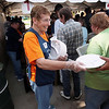 Record-Eagle/Keith King<br /> Alice Gates, a volunteer with Telephone Pioneers of America, hands out plates Sunday, May 20, 2012 during the 57th annual Northwestern Michigan College Barbecue.